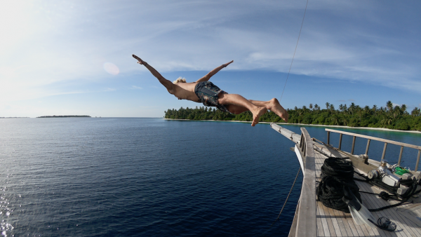 Maldives Boat trip Mahalo Surf Experience -The Jump of Freedom in paradise.